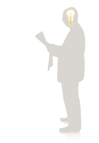 新聞を読む男性のシルエット